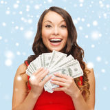 Woman in red dress with us dollar money Royalty Free Stock Photos