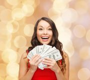Woman in red dress with us dollar money Royalty Free Stock Image