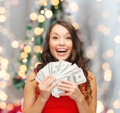 Woman in red dress with us dollar money Stock Images