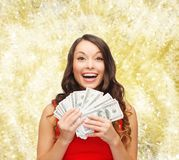Woman in red dress with us dollar money Royalty Free Stock Photography