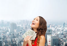 Woman in red dress with us dollar money Stock Photography