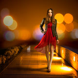 Woman in Red Dress Walking. Night City Stock Photography