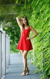 Portrait of beautiful girl outdoors in red dress stock images