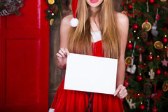 Woman in red dress with white blank over christmas Royalty Free Stock Image