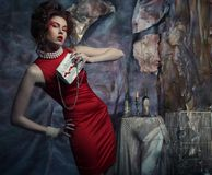 Woman in red dress with white handbag Royalty Free Stock Images