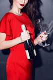 Woman in red dress wich champagne Royalty Free Stock Images