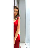 Woman red dress window Royalty Free Stock Photography