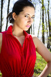 Woman in red dress in woods Royalty Free Stock Images