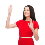 Woman in red dress working with virtual screen Royalty Free Stock Photo