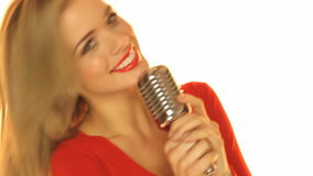 Woman In Red Dresss Holding Microphone Stock Image