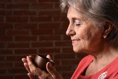 Woman in red drinking coffee Royalty Free Stock Photos