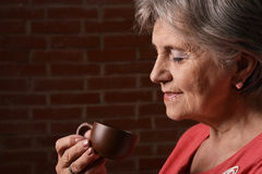 Woman in red drinking coffee Stock Photos