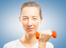 Woman with a red dumbbell Royalty Free Stock Image