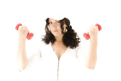 Woman  with red  dumbbells Royalty Free Stock Photo