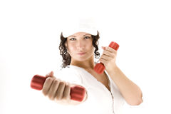 Woman  with red  dumbbells Stock Photos