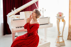 Woman in a red evening dress Royalty Free Stock Image