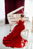 Woman in a red evening dress Royalty Free Stock Photo