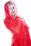 Woman in red fabric on a white Royalty Free Stock Image