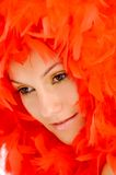 Woman with red feathers Stock Photo