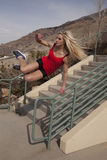 Woman red fitness jump over rail Royalty Free Stock Photo