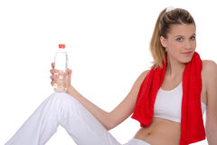 Woman with red fitness towel Stock Photos