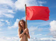 Woman with red flag Royalty Free Stock Photography