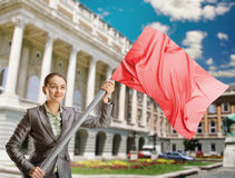 Woman with red flag Stock Images