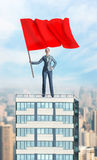 Woman with red flag Royalty Free Stock Image