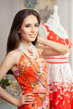 Woman in Red Floral Dress in Fashion Store Stock Images