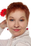 Woman with red flower Stock Image