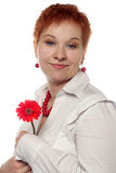 Woman with red flower Royalty Free Stock Image