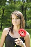 The Woman With A Red Flower Stock Image