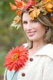 Woman with red flower and fall leaves Stock Photos