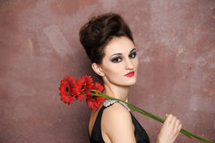 Woman with red flowers Royalty Free Stock Images