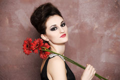 Woman with red flowers Stock Images