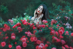Woman with red flowers outdoors. Royalty Free Stock Photo
