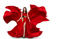 Woman in red fluttering dress Stock Images