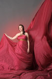 Woman in red flying dress Stock Photography
