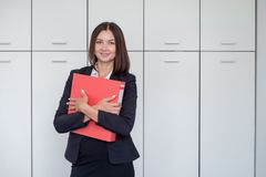 Woman with red folder for documents on white background Royalty Free Stock Photography