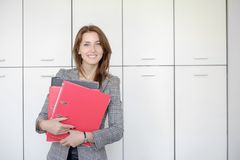 Woman with red folder for documents on white background royalty free stock photos