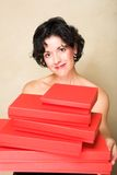 Woman with red gift stock image
