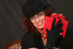 Woman with a red gift Royalty Free Stock Images