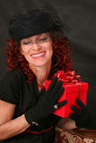Woman with a red gift Stock Photography