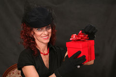 Woman with a red gift Royalty Free Stock Photo