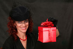 Woman with a red gift Royalty Free Stock Photos