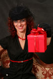 Woman with a red gift Stock Photos