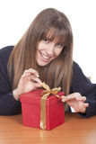 Woman with a red gift box Royalty Free Stock Photos