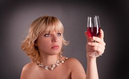 Woman with red glass wine Stock Images