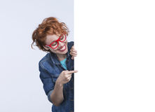 Woman with red glasses show at the banner Stock Photography