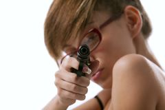 Woman in red glasses taking aim from a gun Stock Image